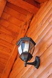 Wall lamp. Outdoor lamp on a wooden wall Royalty Free Stock Photo