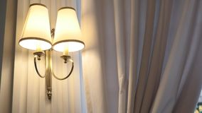 Wall lamp in bedroom. Close up stock footage