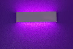 Wall lamp with light shade. Modern wall lamp with light shade on purple cement wall stock photography