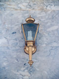 Wall lamp on marble wall Royalty Free Stock Photo