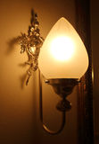 Wall lamp with a shade on the background Royalty Free Stock Photography