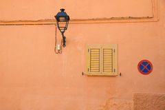 Wall with lamp and sign Stock Image