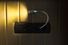 Wall lamp turned on Royalty Free Stock Images