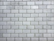 Wall of a large brick. Wall from a large cinder block, a brick wall for a background. Close-up Royalty Free Stock Photo