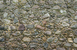 Wall from large granite stones as background Stock Photo