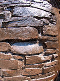 The wall of the large natural stone, painted brown paint Royalty Free Stock Photos