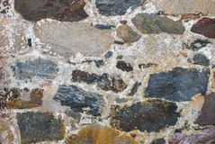 Wall of large natural stones stock photography