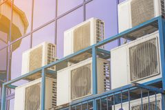 Wall of a large office building with blue windows and air conditioning stock image