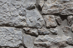 Wall from large stone textured basalt. Good background for wallpaper. Stock Photo