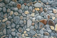 Wall of large stones of different colors royalty free stock images