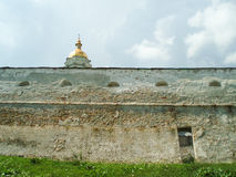 The wall of The Laura. The Kiev-Pecherskaya Laura (or Kiev Laura of the Caves) is the monastery of the highest rank in Ukraine, based in 1051 royalty free stock photography