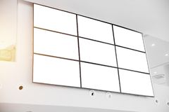 Wall LCD display screen panel in modern office building. With clipping path at blank screen Stock Photo