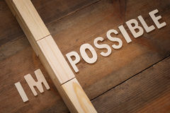 Wall between of the letters IM from the word impossible Stock Image