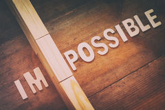 Wall between of the letters IM from the word impossible Royalty Free Stock Images