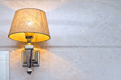Wall light. A wall light with a shade turned on Royalty Free Stock Images