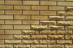 Wall of light smooth and uneven bricks. Laying of light smooth and uneven brick in the wall of the house royalty free stock photography