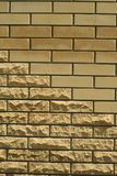 Wall of light smooth and uneven bricks. Laying of light smooth and uneven brick in the wall of the house, vertical shot royalty free stock photo