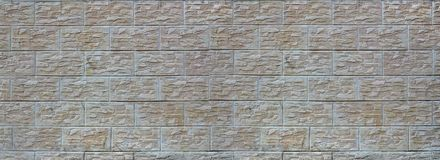 Wall of light texture tiles, stylized in appearance as a brick. One of the types of wall decoratio. N royalty free stock images