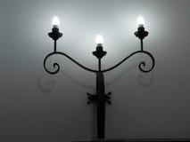 Wall Light. Three armed wrought iron wall light Royalty Free Stock Photography