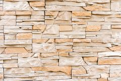Wall of light untreated stone. royalty free stock photos