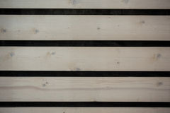 Wall of light wooden planks with gaps Stock Photos