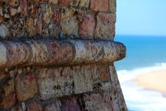 Wall of a lighthouse. Close up of a wall of stones of a lighthouse wall with the beach in background Stock Photography