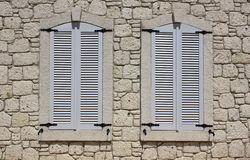 Wall of limestone masonry with windows Stock Photo