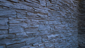 A wall lined with decorative stone Stock Photo