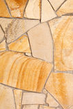 Wall lined with porphyry stones Royalty Free Stock Photos