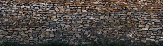 Wall. A wall lined with stone Stock Images
