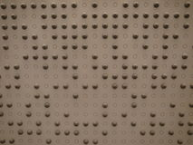 A wall with little spheres Stock Images
