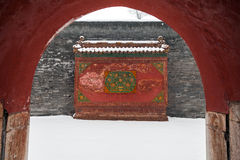 Ancient chinese architecture in winter. Wall located inside and outside gate of building Stock Images