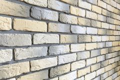 Wall with loft brick facing in yellow, white and gray Stock Image