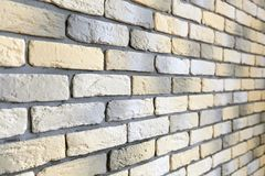 Wall with loft brick facing in yellow, white and gray Stock Photos
