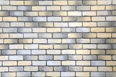 Wall with loft brick facing in yellow, white and gray Royalty Free Stock Images