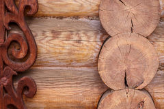 The wall of the log house with carved pattern Stock Photography