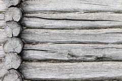 Wall of a log house. Log-house. Background, texture in the form of logs. The photo shows the wall of a Russian log cabin. Photo taken on a cloudy day Stock Photo