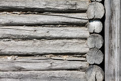 Wall of a log house. Log-house. Background, texture in the form of logs. The photo shows the wall of a Russian log cabin. Photo taken on a sunny day with deep Royalty Free Stock Image