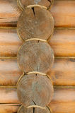 Wall from logs. The texture of the old logs. Corner of the wall close-up Stock Photo