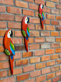 Wall with macaws. Brick wall with tropical decor with macaws Stock Images