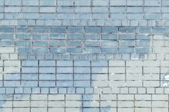 The wall is made of bricks of celeste and blue color. Background of smooth masonry. Texture. The wall is made of bricks of celeste and blue color. Beautiful Stock Photos