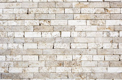 Wall made with bricks of marble. Royalty Free Stock Image