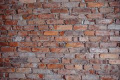 Wall made with brown bricks mixed randomly with small black ones. Background and texture with copy space.  stock image