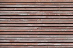 Wall made of brown wooden slats. For background or texture Royalty Free Stock Photography
