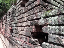Wall made of clay. A continuous vertical brick or stone structure that encloses or divides an area of land stock photo