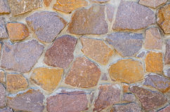 Wall made of colored stones. An abstract and unusual colored stone wall Royalty Free Stock Photography