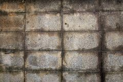 Wall made of concrete blocks do not paint over the plaster and water stains are caused by old wall. S stock photography