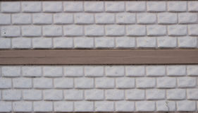Wall made of decorative stone blocks. Painted in white Stock Images