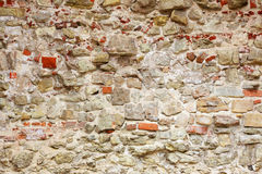 Wall made of different stones Stock Photos