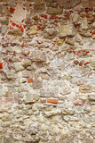 Wall made of different stones Stock Photography
